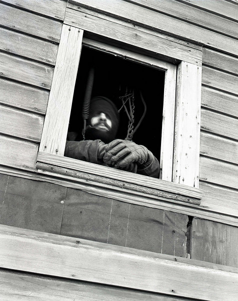46859172_guy in window
