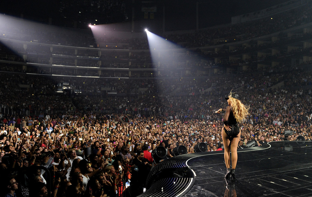 ". Singer Beyonce performs on her ""Mrs. Carter Show World Tour 2013\"" at Staples Center on Monday, July 1, 2013, in Los Angeles. Beyonce is wearing a custom hand beaded one-piece by Givenchey.  (Photo by Frank Micelotta/Invision for Parkwood Entertainment/AP Images)"