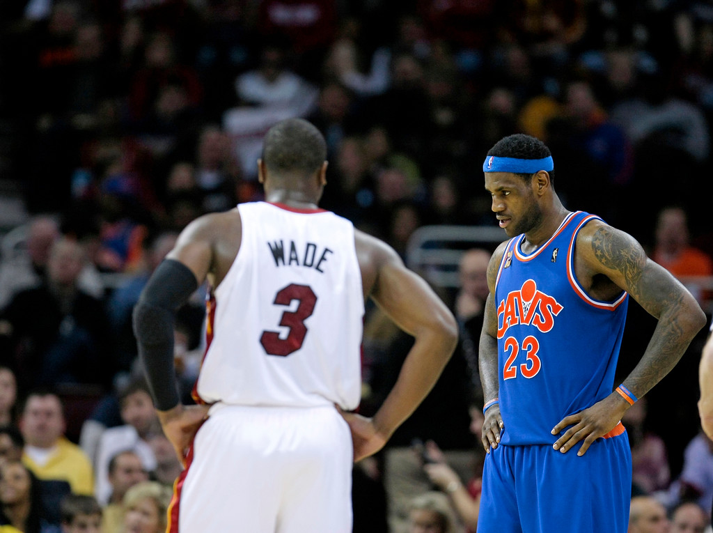 . Cleveland Cavaliers\' LeBron James (23) and Miami Heat guard Dwyane Wade (3) during a break in an NBA basketball game Thursday, Feb. 4, 2010, in Cleveland. (AP Photo/Tony Dejak)