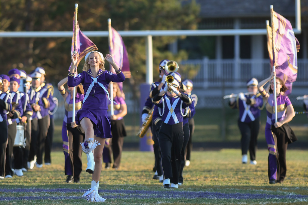 . Head Majorette Haley Nabors leads the Vermilion High School Marching Band on to the field prior to the start of the Sailors\' football game against the Firelands Falcons, Sept. 9, 2016. The Sailors\' field is grass. (Eric Bonzar�The Morning Journal)