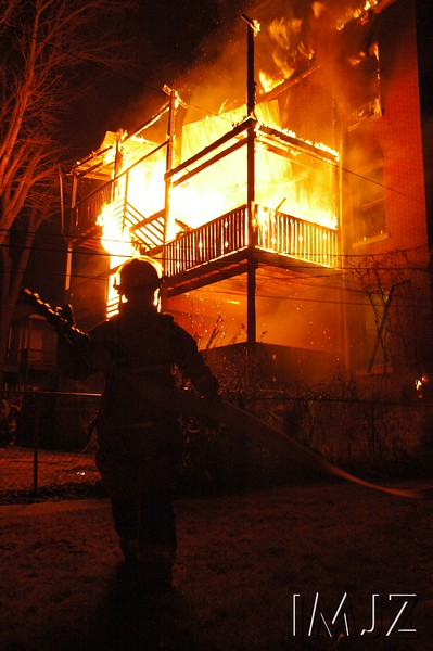 Louisville Firefighters put out a blaze on Bonnycastle Ave.  in the Highlands. March 7, 2008.