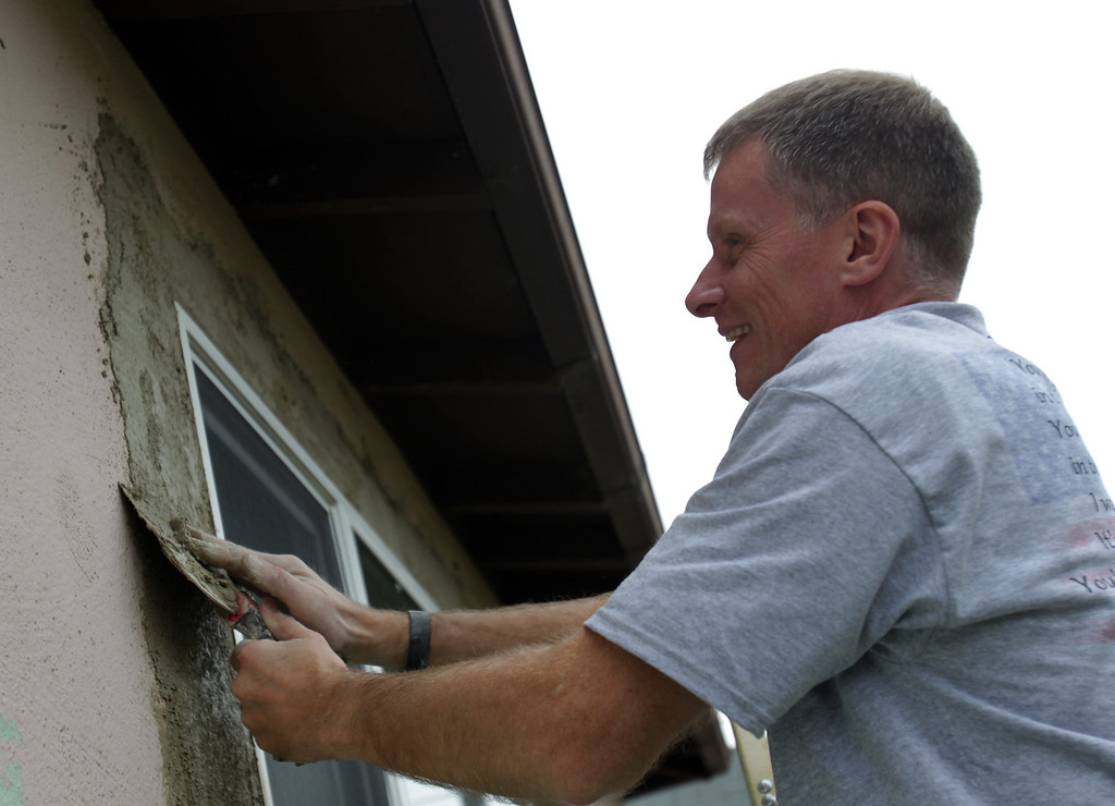 . Ed Roshitsh, of San Francisco, a volunteer with House of Heroes repairs a window at the home of Navy veteran Joseph Catalano in Hayward, Calif., on Thursday, Jan. 24, 2013. The Columbus, Ga. nonprofit House of Heroes is partnering with Home Depot to repair 36 houses owned by military and public safety veteran or their spouses  around the nation. (Anda Chu/Staff)