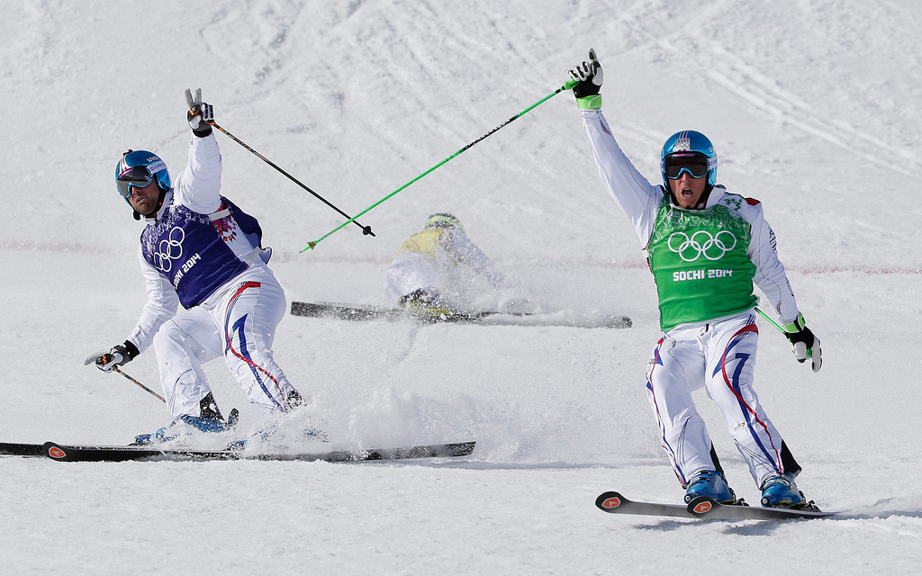 . France\'s Jean Frederic Chapuis, right, celebrates after crossing the line to win the gold medal in the men\'s ski cross final, ahead of silver medalist Arnaud Bovolenta, of France, left, and bronze medalist Jonathan Midol of France, center, at the Rosa Khutor Extreme Park, at the 2014 Winter Olympics, Thursday, Feb. 20, 2014, in Krasnaya Polyana, Russia.  (AP Photo/Andy Wong)
