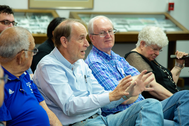 Jim Moloney makes a comment during the Q&A section of the forum.
