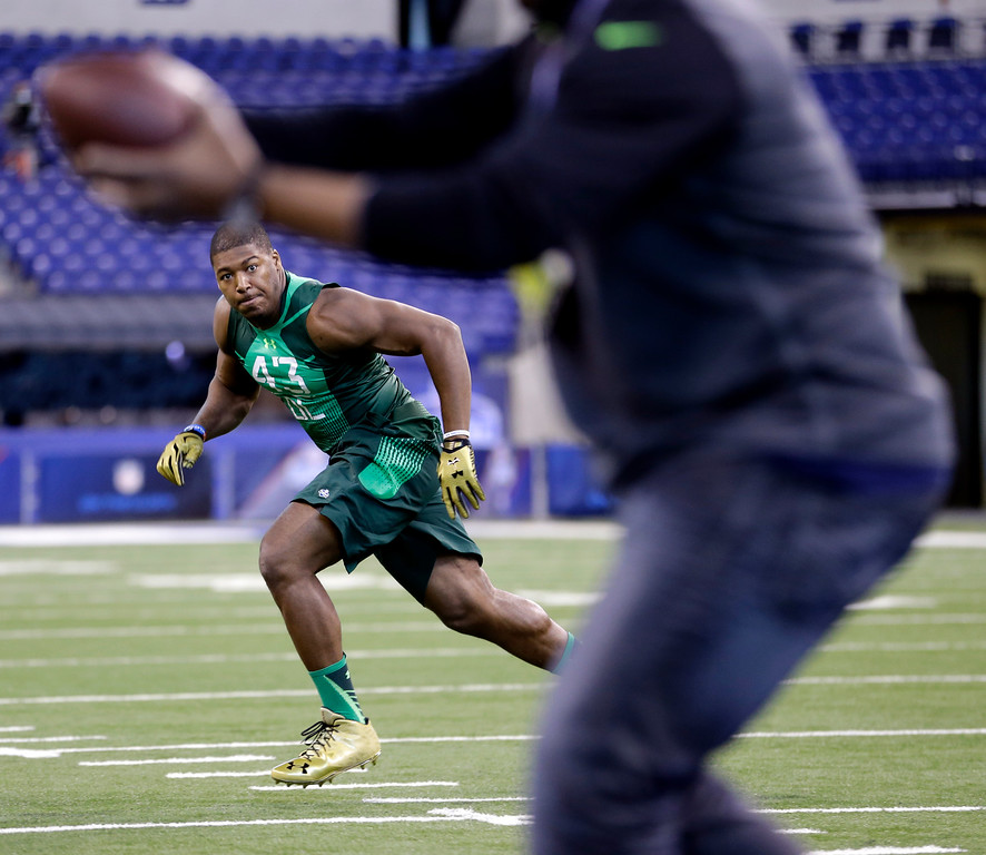 . Purdue defensive lineman Ryan Russell runs a drill at the NFL football scouting combine in Indianapolis, Sunday, Feb. 22, 2015. (AP Photo/Julio Cortez)