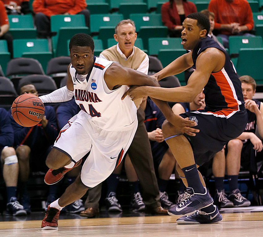 . Arizona\'s Solomon Hill, left, drives to the basket past Belmont\'s Blake Jenkins during the first half of a second-round game in the NCAA college basketball tournament in Salt Lake City Thursday, March 21, 2013. (AP Photo/George Frey)