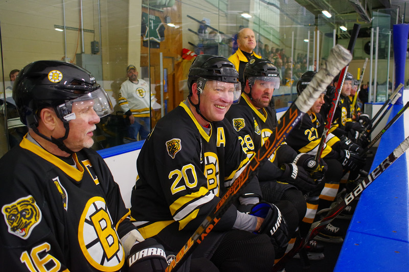 Rick Middleton (12), Bob Sweeney (20) and Dan LaCouture (28) share a laugh on the bench during the first period.
