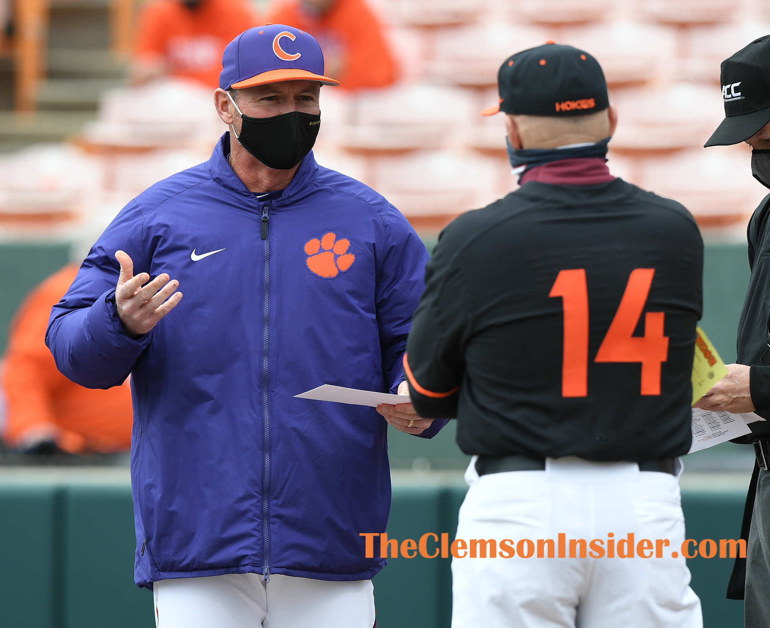 Clemson head coach Monte Lee (18) meets with Virginia Tech head coach Corey Haines at home plate before their game Friday, March 19, 2021 at Clemson's Doug Kingsmore Stadium. Bart Boatwright/The Clemson Insider