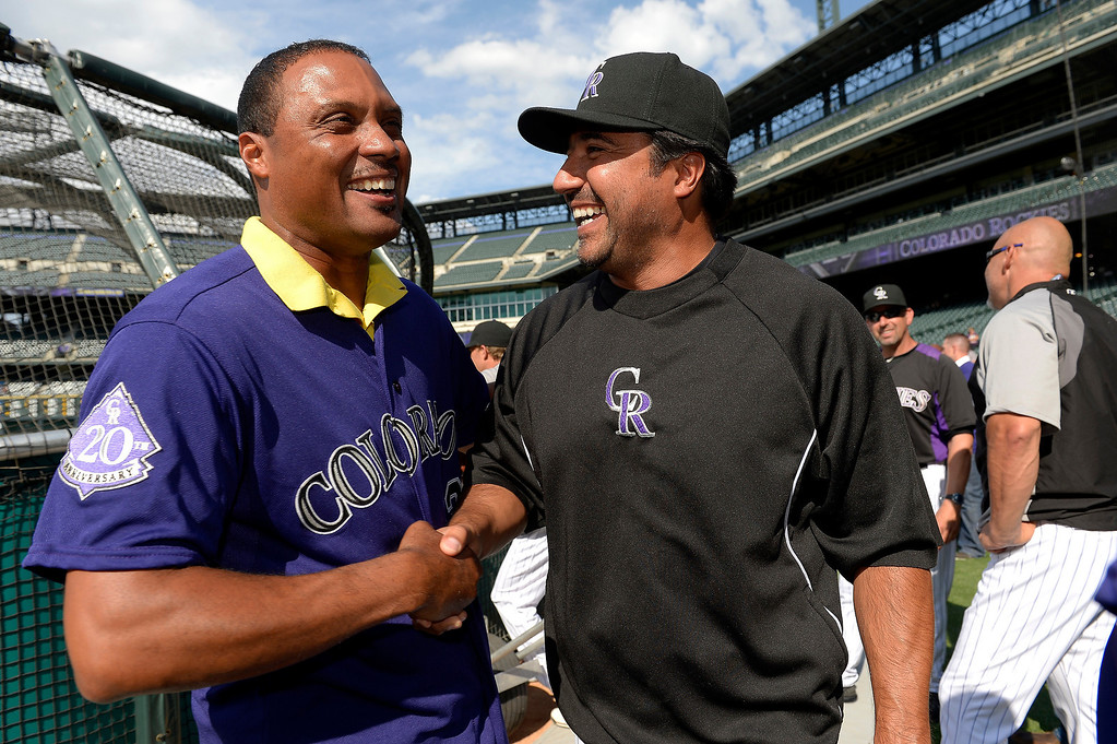 . Colorado Rockies Vinny Castilla (R) shares a laugh with Terry Shumpert during an open workout session for the fans July 18, 2013 at Coors Field. (Photo By John Leyba/The Denver Post)