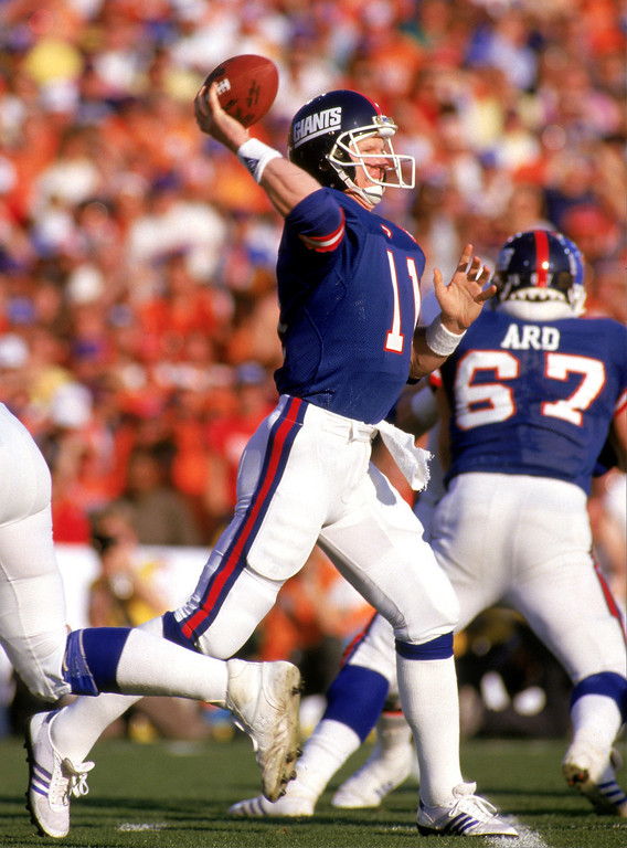 . Quarterback Phil Simms #11 of the New York Giants passes against the Denver Broncos during Super Bowl XXI at the Rose Bowl on January 25, 1987 in Pasadena, California.   (Photo by George Rose/Getty Images)