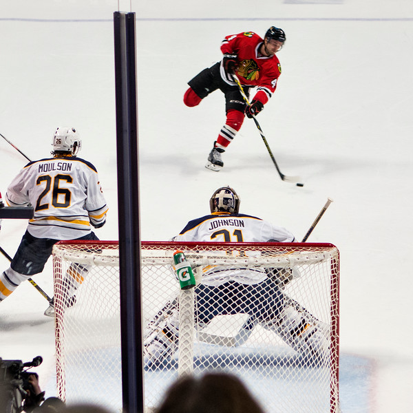 Niklas Hjalmarsson skates for  a shot on goal - two of four.