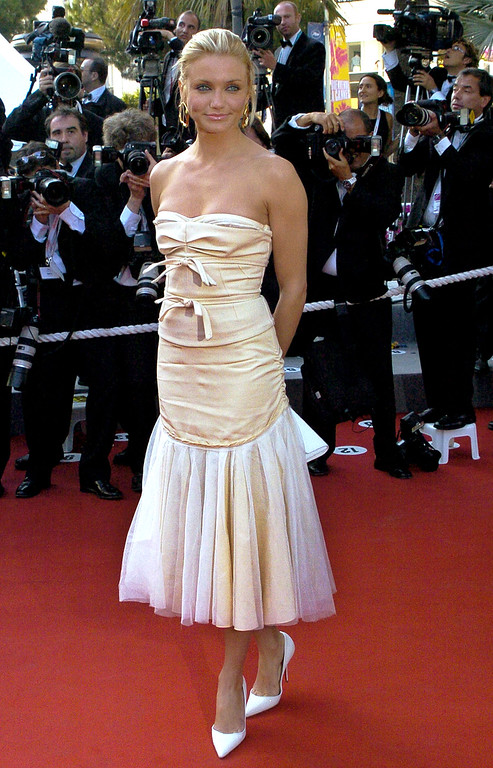 ". American actress Cameron Diaz, poses as she arrives for the screening of the animated film ""Shrek 2,\"" in competition, directed by New Zealander Andrew Adamson, American Kelly Asbury and American Conrad Vernon, at the 57th International Film Festival in Cannes, southern France, Saturday, May 15, 2004. (AP Photo/Lionel Cironneau)"