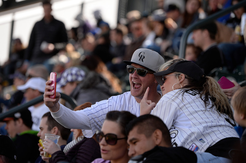 . Dillon Estep and Katie  Bennington, both of Denver, shoot a selfie during the Colorado Rockies home opener against the Arizona Diamondbacks at Coors Field in Denver, CO April 04, 2014. (Photo By Craig F. Walker / The Denver Post)