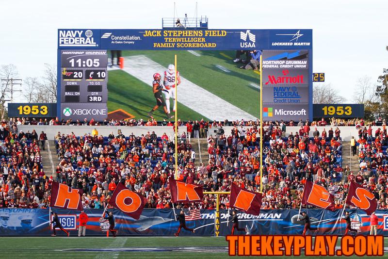 The Hokies Cheerleaders run out with their flags after the TD. (Mark Umansky/TheKeyPlay.com)