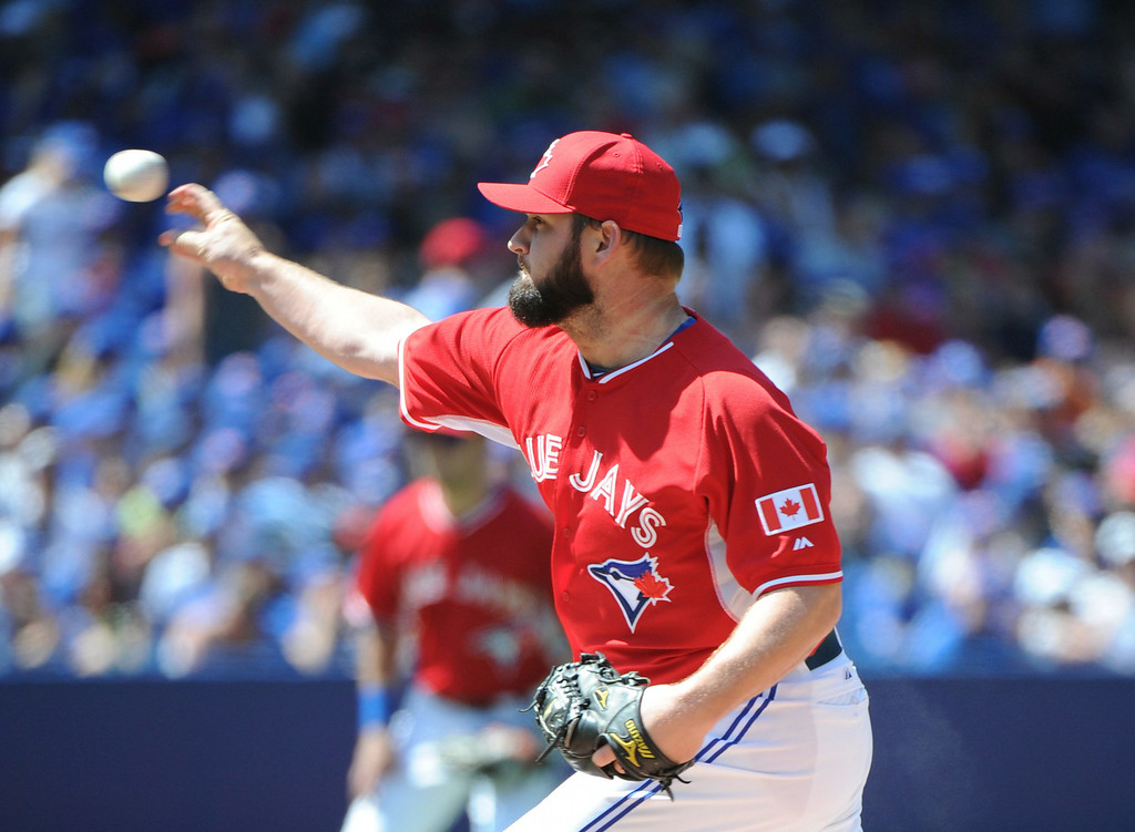 . Toronto Blue Jays\' Todd Redmond pitches against the Detroit Tigers during the fourth  inning of a baseball game on Sunday, Aug. 10, 2014, in Toronto. (AP Photo/The Canadian Press, Jon Blacker)
