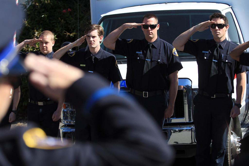 . Paramedics salute during funeral services for Santa Clara paramedic Quinn Boyer, 34, of Dublin, at St. Theresa Catholic Church in Oakland, Calif., on Tuesday, April 16, 2013.  (Jane Tyska/Staff)
