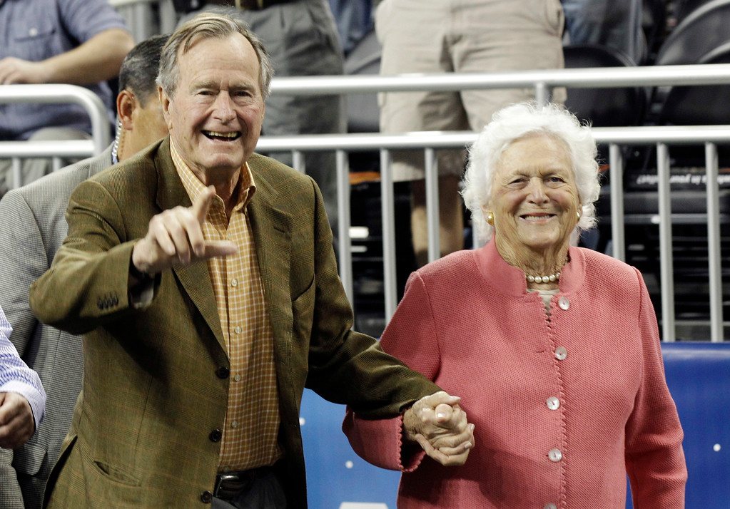 . Former President George H. Bush and his wife Barbara Bush arrive before a men\'s NCAA Final Four semifinal college basketball game Saturday, April 2, 2011, in Houston. (AP Photo/David J. Phillip)