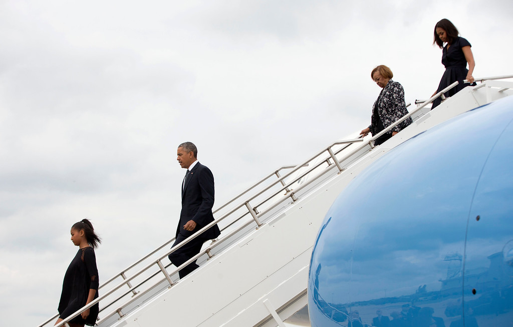 . President Barack Obama, and family, from left, daughter Sasha, mother-in-law Marian Robinson, and first lady Michelle Obama get off Air Force One upon their arrival at Delaware Air National Guard base in New Castle, Del., Saturday,  June 6, 2015. The First Family was traveling to Wilmington, Del. to attend the funeral service of former Delaware Attorney General Beau Biden, the vice president\'s eldest son. Biden died of brain cancer at the age 46. (AP Photo/Pablo Martinez Monsivais)