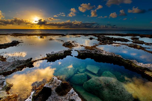 MAY 31: SUNSET IN REFLECTING POOLS OF SABANETA