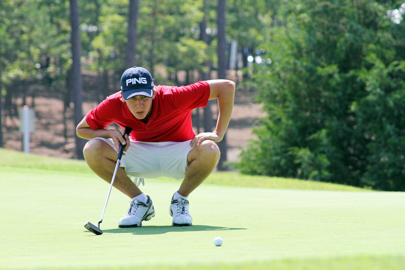 Carlos Ortiz takes a deep breath before standing over this putt on the 17th green during the third round of the 2013 Western Amateur at The Alotian Club in Roland, AR. (WGA Photo/Ian Yelton)