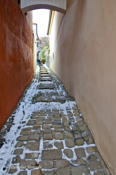 Narrow cobblestone walkway with snow in Bratislava