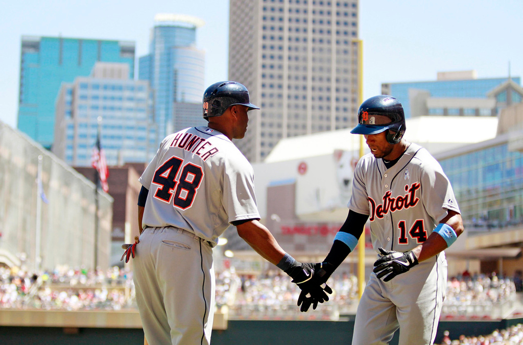 . Detroit\'s Austin Jackson, right, is congratulated by teammate Torii Hunter after Jackson hit a two-run home run against Twins starting pitcher P.J. Walters during the fourth inning. (AP Photo/Genevieve Ross)