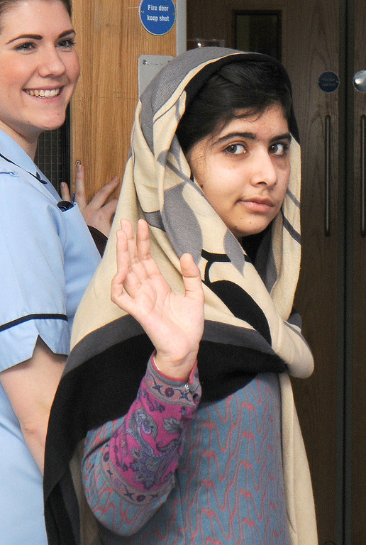 . In this handout picture received on January 4, 2013 and taken January 3, 2013 from the Queen Elizabeth Hospital in Birmingham injured 15 year-old Pakistani schoolgirl Malala Yousafzai waves as she is discharged from the Queen Elizabeth Hospital in Birmingham in central England.  AFP PHOTO / QUEEN ELIZABETH HOSPITAL /AFP/Getty Images