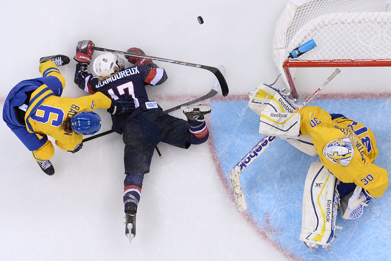 . US Jocelyne Lamoureux (#17) vies with Sweden\'s Lina Backlin and Sweden\'s goalkeeper Kim Martin Hasson (R) during the Women\'s Ice Hockey Semifinals USA vs Sweden at the Shayba Arena during the Sochi Winter Olympics on February 17, 2014.   AFP PHOTO / JONATHAN NACKSTRANDJONATHAN NACKSTRAND/AFP/Getty Images