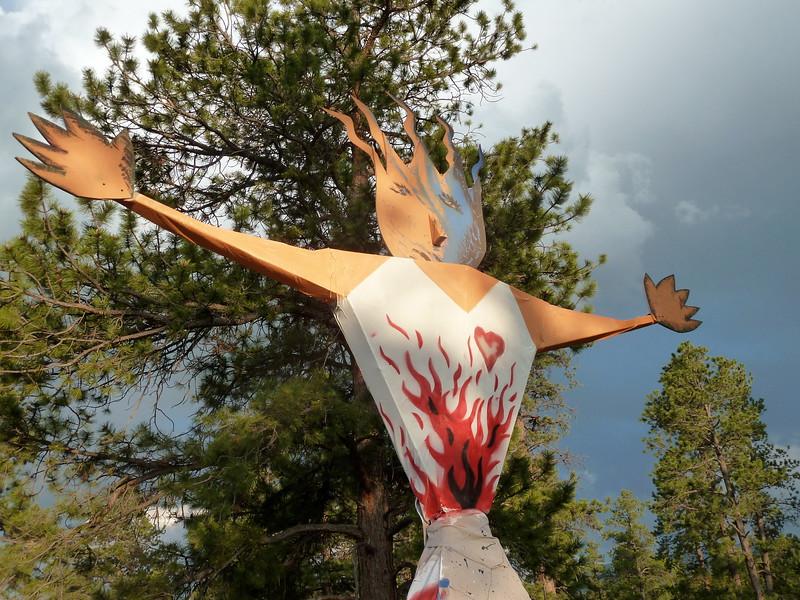 A firy figure offers free hugs