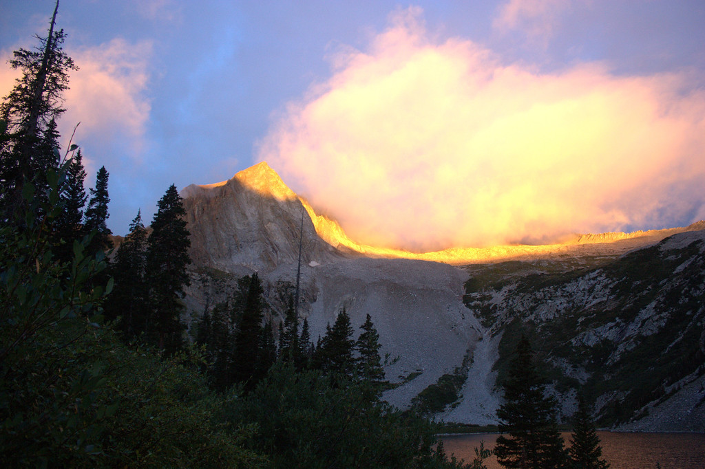 . Sunrise on Snowmass Mountain. Luke DeMuth and Junaid Dawud have hiked 1,300 miles and climbed 57 of the state\'s 58 14,000-foot peaks and plan to finish their 70-day mission Sunday on Longs Peak.