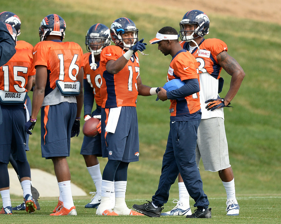 . Denver Broncos wide receiver Nathan Palmer (13) chats with Denver Broncos wide receiver Emmanuel Sanders (10) and Denver Broncos wide receiver Demaryius Thomas (88) during drills on day 12 of the Denver Broncos 2014 training camp August 5, 2014 at Dove Valley. (Photo by John Leyba/The Denver Post)