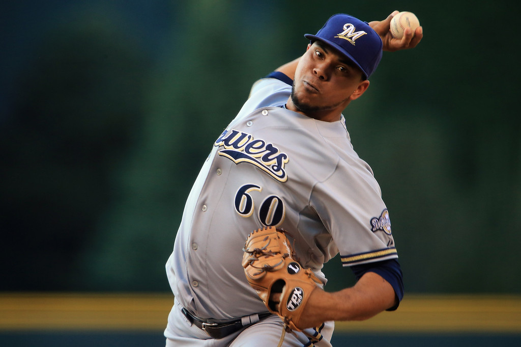 . DENVER, CO - JULY 26:  Starting pitcher Wily Peralta #60 of the Milwaukee Brewers delivers against the Colorado Rockies at Coors Field on July 26, 2013 in Denver, Colorado.  (Photo by Doug Pensinger/Getty Images)