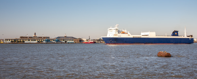 Gravesend, England, UK - September 21, 2010: A roll on-roll off cargo ferry sails the London International Cruise Terminal on the Thames Estuary at Tilbury Docks in Essex.