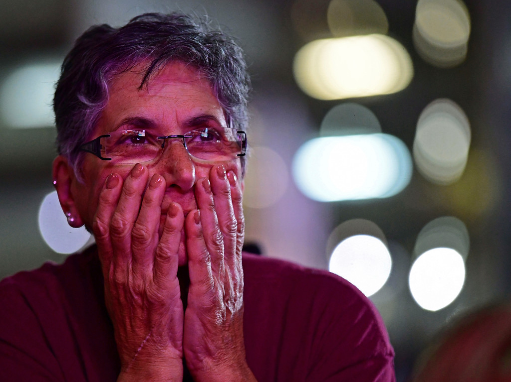 . Cleveland Cavaliers fan Bernadette Nackley reacts during a watch party outside Quicken Loans Arena for Game 4 of basketball\'s NBA Finals between the Cavaliers and the Golden State Warriors, Friday, June 8, 2018, in Cleveland. Golden State won 108-85 to sweep the series. (AP Photo/David Dermer)