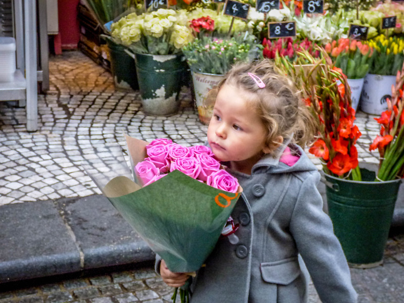Little girl with flowers - Paris, France