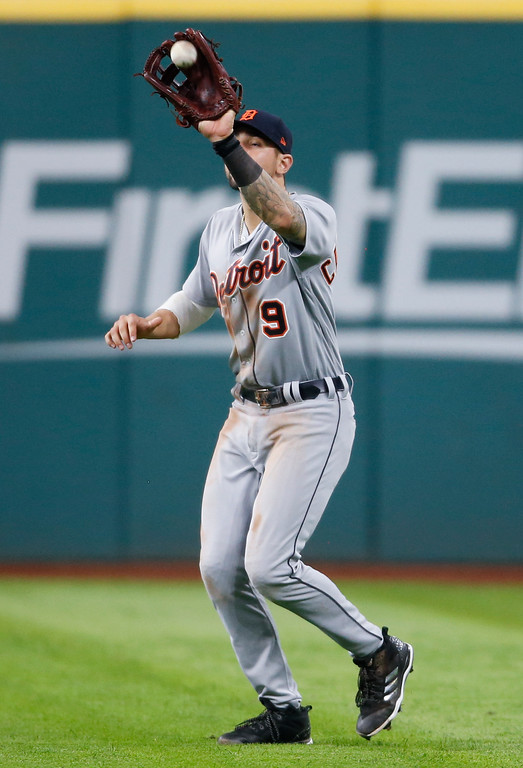 . Detroit Tigers\' Nicholas Castellanos makes a catch to get out Cleveland Indians\' Michael Brantley during the fifth inning of a baseball game, Friday, Sept. 14, 2018, in Cleveland. (AP Photo/Ron Schwane)