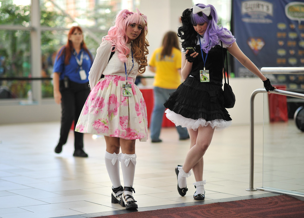 . DENVER, CO. - MAY 31: Kao, left, and Hika of Characters IRL celebrate opening day of Denver Comic Con at Colorado Convention Center. Denver, Colorado. May 31, 2013. (Photo By Hyoung Chang/The Denver Post)