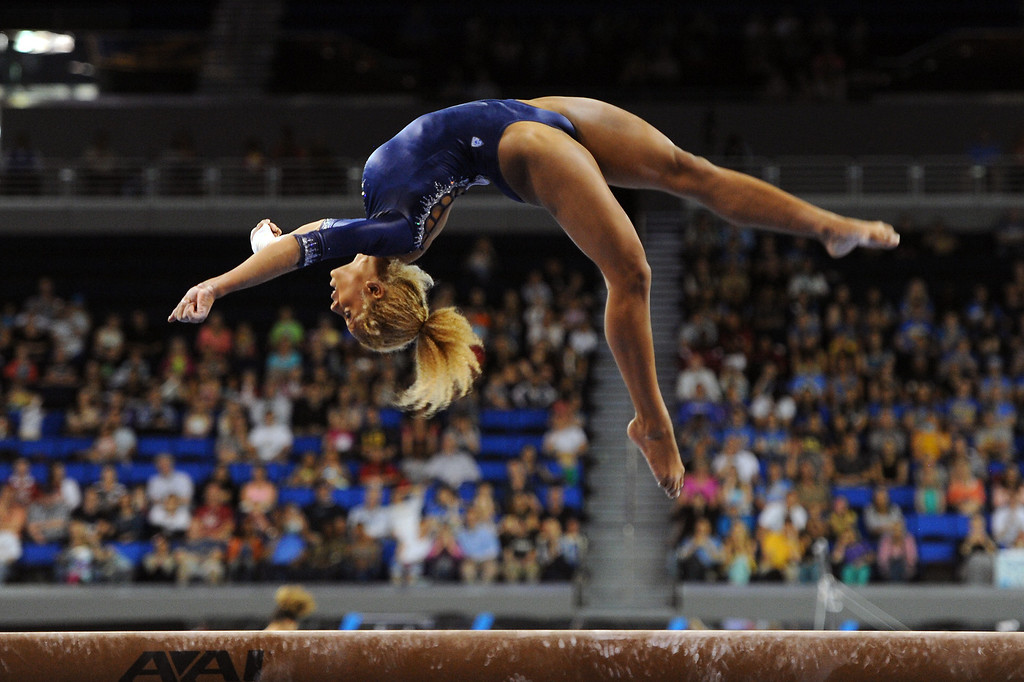 . UCLA\'s Danusia Francis competes on the balance beam at the NCAA Women\'s Gymnastics Championship Team Finals at Pauley Pavilion, Saturday, April 20, 2013. (Michael Owen Baker/Staff Photographer)