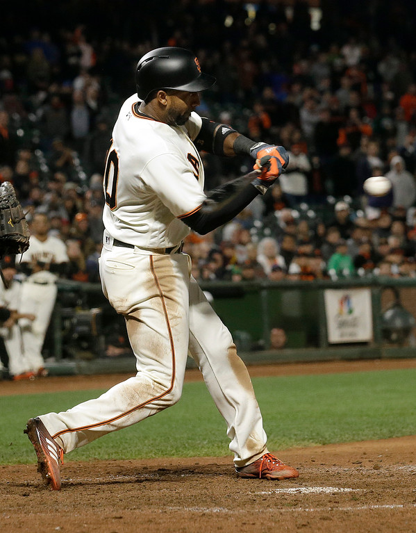 . San Francisco Giants\' Eduardo Nunez singles to drive in the winning run during the 10th inning against the Cleveland Indians in a baseball game in San Francisco, Tuesday, July 18, 2017. The Giants won 2-1. (AP Photo/Jeff Chiu)