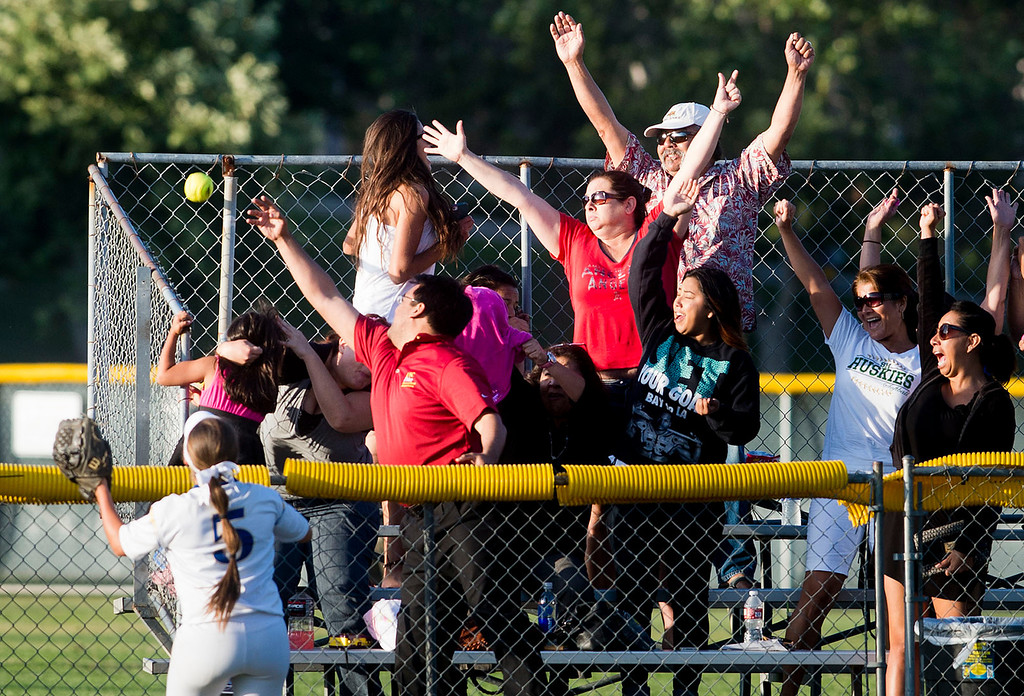 . Fans cheers after South Hills\' Natalie Moran hits a home run over the fence during San Gabriel Valley all-star softball game at Diamond Bar High School on Monday, June 3, 2013. South team won 10-5. (Staff photo by Watchara Phomicinda/ Los Angeles Media News Group)