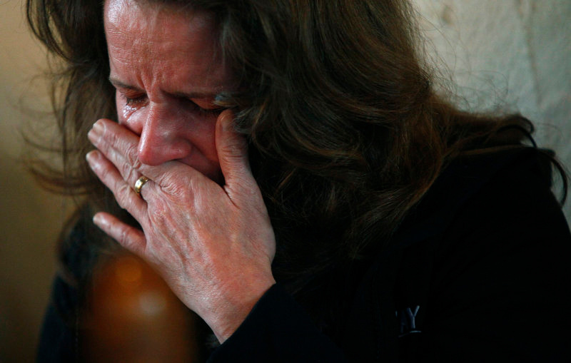 Description of . A woman cries during a prayer service at St. John's Episcopal church near Sandy Hook Elementary School in Sandy Hook, Connecticut December 15, 2012. Residents of the small Connecticut community of Newtown were reeling on Saturday from one of the worst mass shootings in U.S. history, as police sought answers about what drove a 20-year-old gunman to slaughter 20 children at an elementary school. REUTERS/Eric Thayer