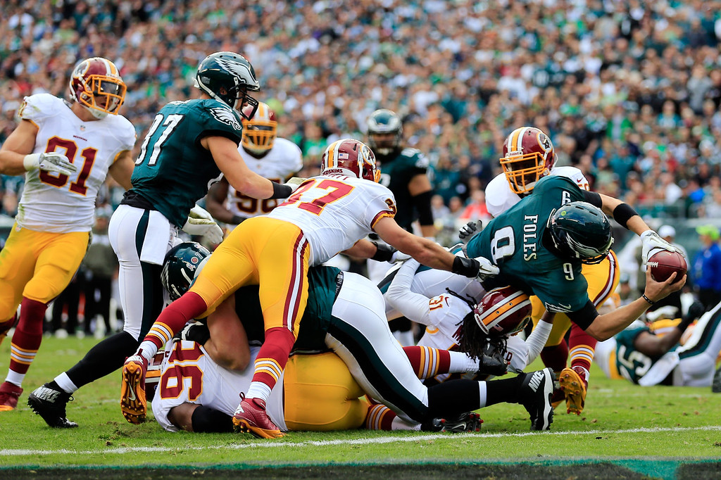 . Quarterback Nick Foles #9 of the Philadelphia Eagles rushes for a first quarter touchdown against the Washington Redskins at Lincoln Financial Field on November 17, 2013 in Philadelphia, Pennsylvania.  (Photo by Rob Carr/Getty Images)