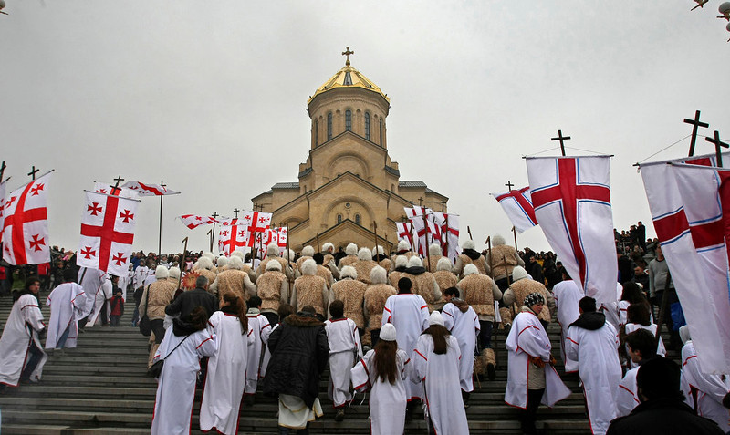 . Georgians take a part in a religious procession to mark the Orthodox Christmas in Tbilisi, Georgia, Monday,  Jan. 7, 2013. Christmas falls on Jan. 7 for Orthodox Christians that use the old Julian calendar instead of the 16th-century Gregorian calendar adopted by Catholics and Protestants and commonly used in secular life around the world. (AP Photo/Shakh Aivazov)