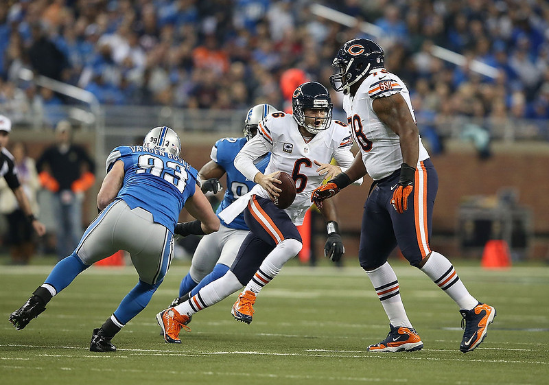 . Jay Cutler #6 of the Chicago Bears rolls out to pass during the game against the Detroit Lions at Ford Field on December 30, 2012 in Detroit, Michigan. The Bears defeted the Lions 26-24.  (Photo by Leon Halip/Getty Images)