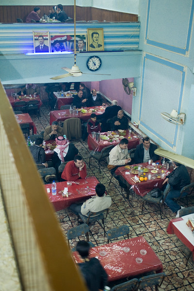 Aleppo, Syria - January, 2008: Local restaurant in Aleppo, with several photos of the Syrian President Bashar al-Assad, along with Hezbollah leaders on the wall. (Photo by Christopher Herwig)