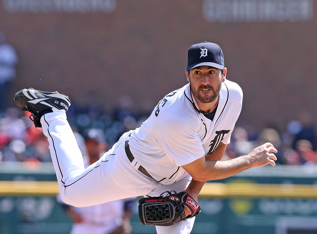 . Justin Verlander #35 of the Detroit Tigers pitches in the first inning of the  Opening Day game against the Kansas City Royals at Comerica Park on March 31, 2014 in Detroit, Michigan.  (Photo by Leon Halip/Getty Images)