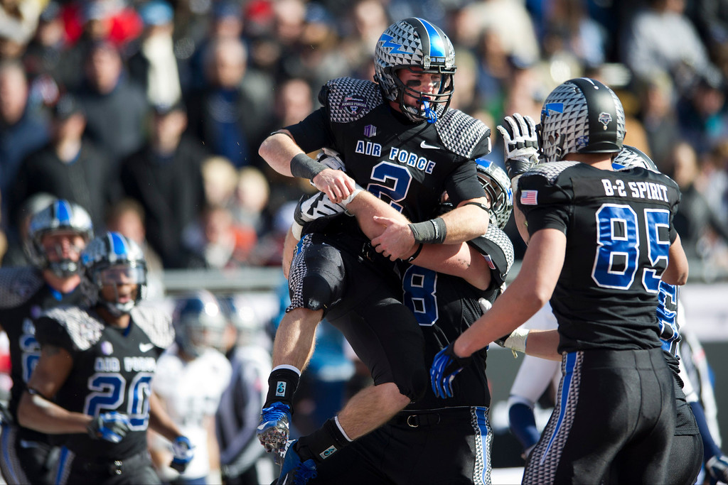 . Kale Pearson #2 of the Air Force Falcons celebrates after a 9-yard touchdown run against the Rice Owls during the Bell Helicopter Armed Forces Bowl on December 29, 2012 at Amon G. Carter Stadium in Fort Worth, Texas.  (Photo by Cooper Neill/Getty Images)