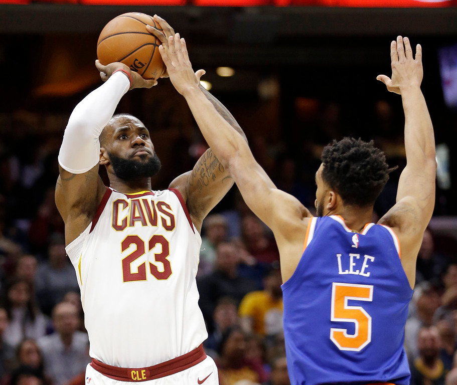 . Cleveland Cavaliers\' LeBron James (23) shoots over New York Knicks\' Courtney Lee (5) in the first half of an NBA basketball game, Sunday, Oct. 29, 2017, in Cleveland. (AP Photo/Tony Dejak)