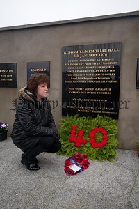 Racquel Brush lays a wreath at the Kingsmill Memorial. R1601022
