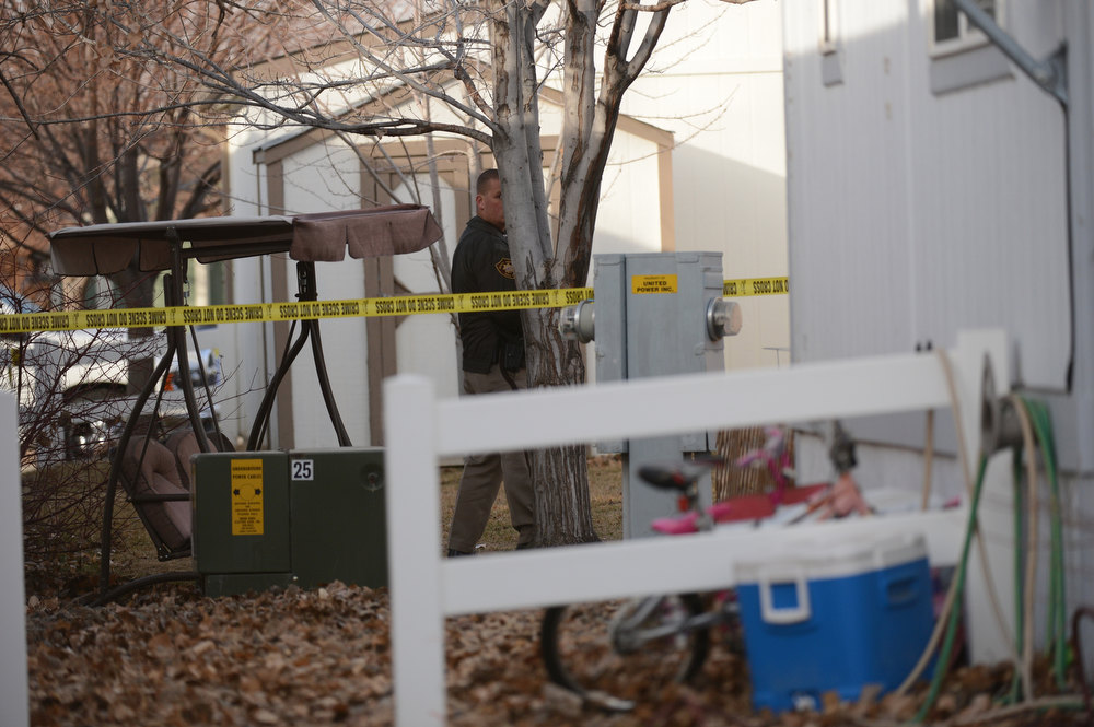 . Police investigate a crime, Tuesday, December 18, 2012, where four people were found dead in a home in Longmont. RJ Sangosti, The Denver Post